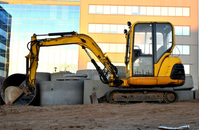Mini excavator on a construction site stock image