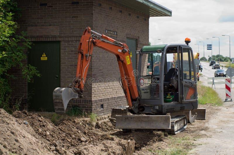 Mini excavator. At work site royalty free stock image