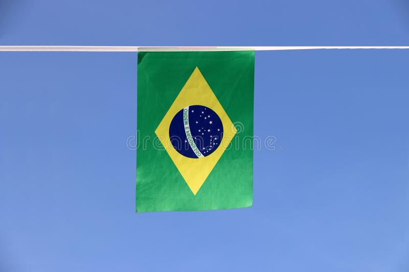 Mini fabric rail flag of Brazil, a blue disc depicting a starry sky with the national motto Order and Progress. stock photography
