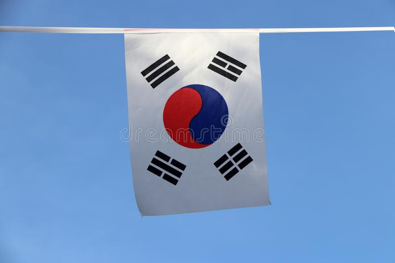 Mini fabric rail flag of South Korea, a white rectangular background, a red and blue Taeguk, symbolizing balance. Mini fabric rail flag of South Korea, a white royalty free stock image