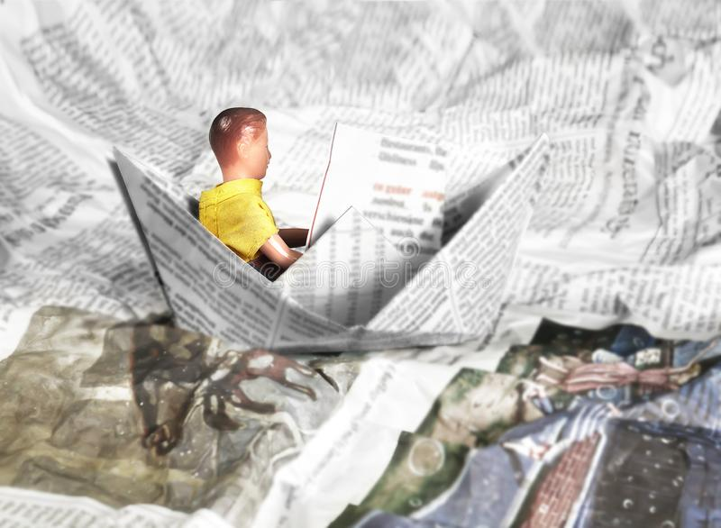 Mini Figure of Man or Child with Newspaper in Boat, Sailing in Information Sea. Mini Figure of Young Man or Child with Newspaper in Boat, Sailing in Information royalty free stock images