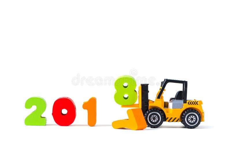Mini forklift ciężarówki ładowniczy tekst liczba osiem uzupełniać rok 2 obraz stock