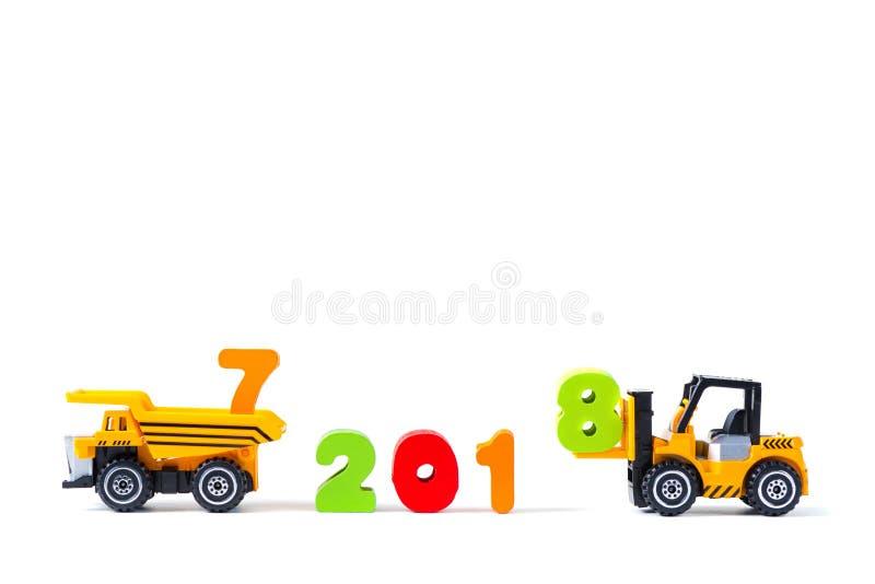 Mini forklift ciężarówki ładowniczy tekst liczba osiem uzupełniać rok 2 obrazy royalty free