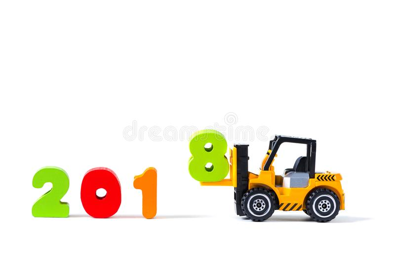 Mini forklift truck loading text number eight to complete year 2 royalty free stock image