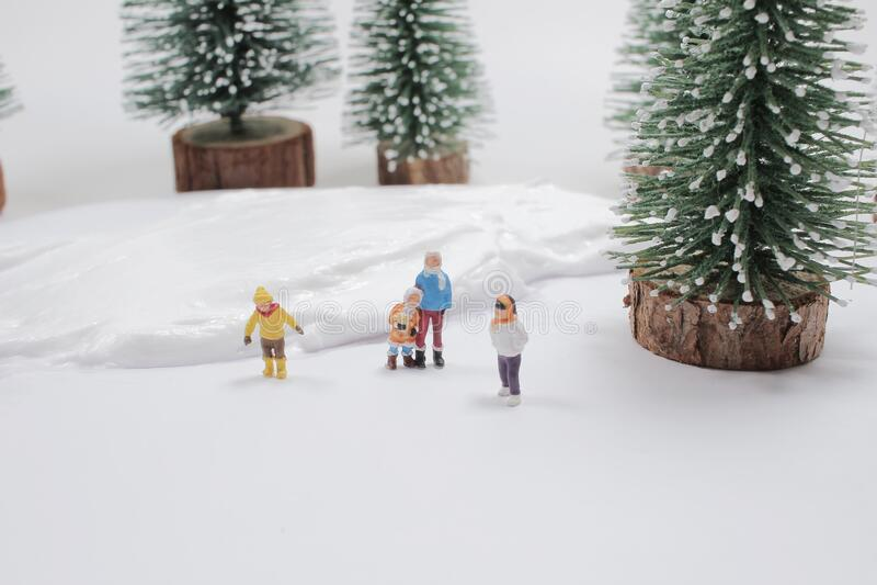 Mini of fun figure in snow covered winter landscape stock image