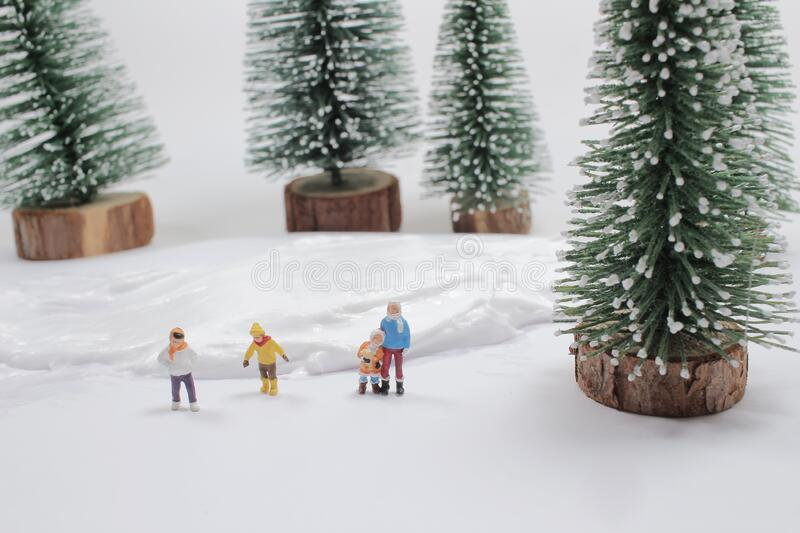 Mini of fun figure in snow covered winter landscape royalty free stock photography