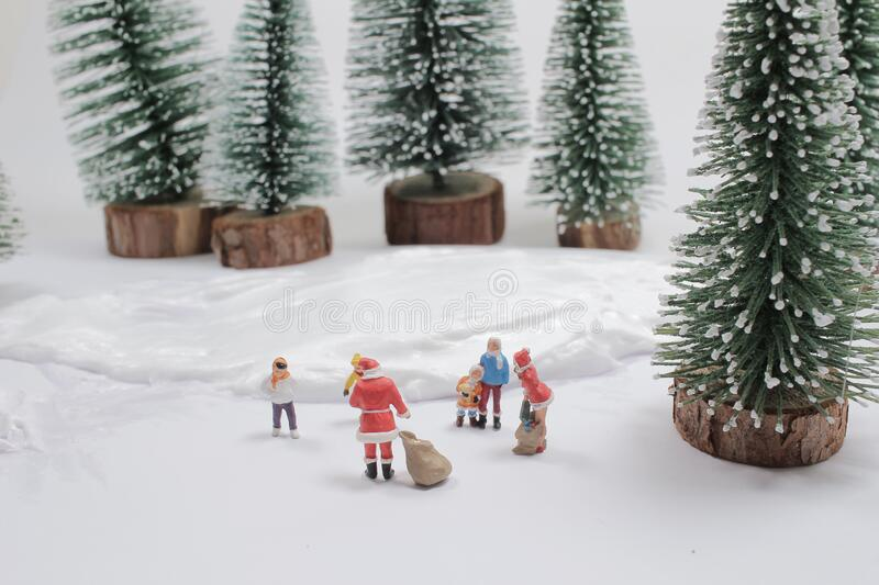 Mini of fun figure in snow covered winter landscape royalty free stock images