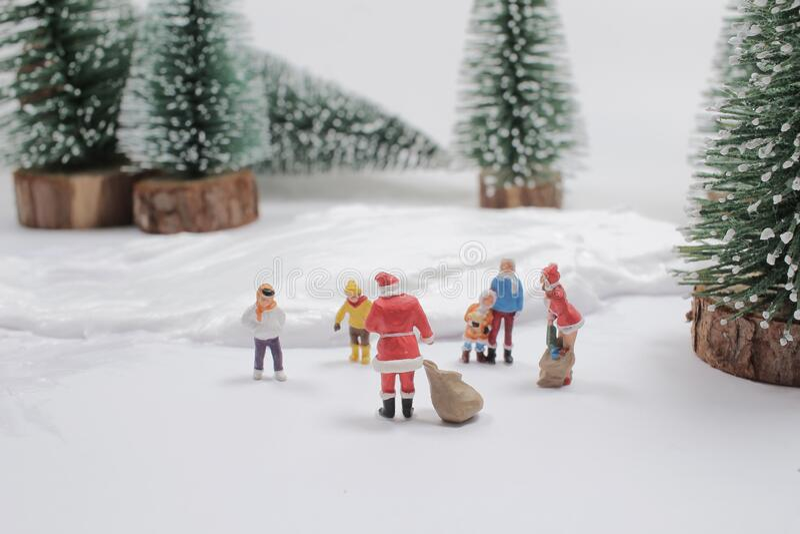 Mini of fun figure in snow covered winter landscape stock photo