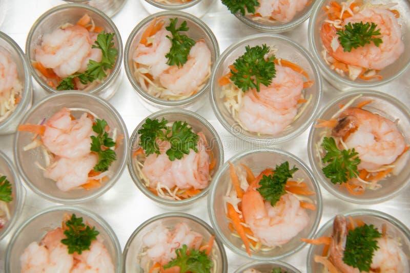 Mini glass shrimp cocktail with cocktail sauce stock photo