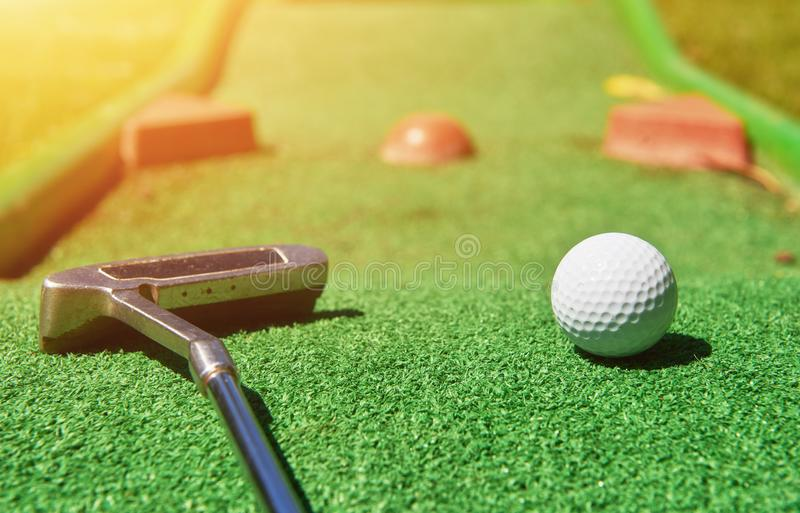 Mini-golf ball on artificial grass. Summertime. royalty free stock photography
