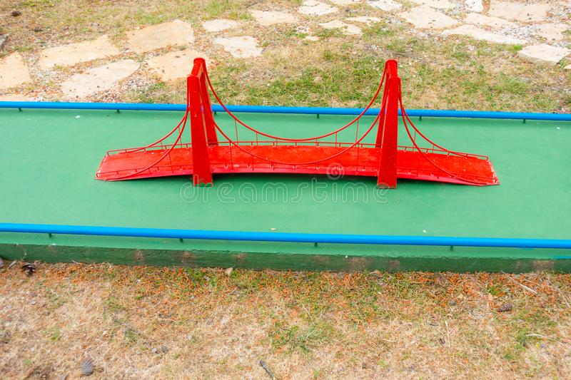 Mini golf course with obstacles stock images