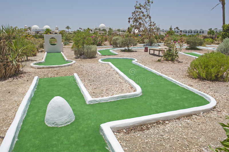 Mini golf course at at tropical hotel resort royalty free stock photography