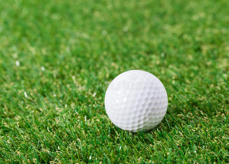 Mini golf equipment. On green grass royalty free stock photo