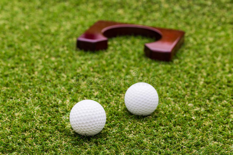 Mini golf equipment. On green grass stock image