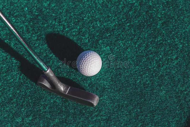 Mini golf putter club and ball stock photo