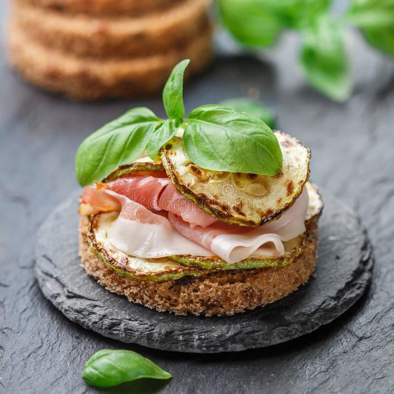 Mini ham hamon, prosciutto sandwiches, fried zucchini and Basil stock photography
