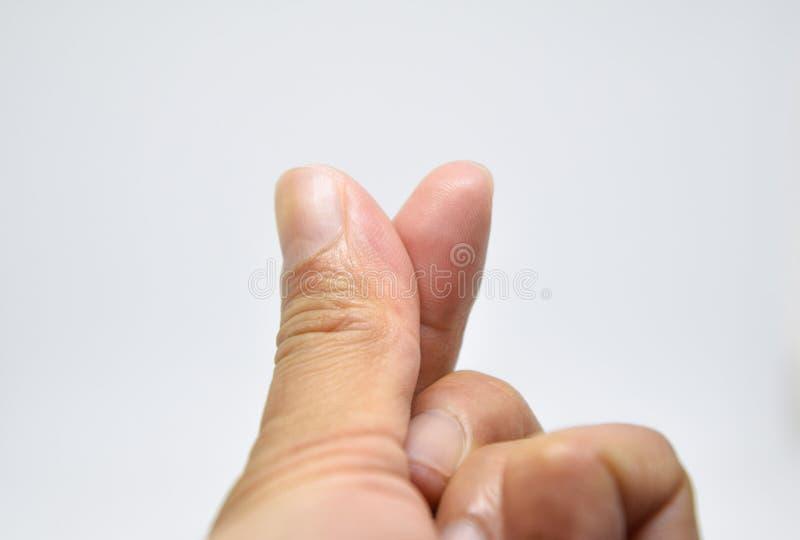 Mini Heart - usando la cruz del dedo índice del pulgar y para transportar el th fotografía de archivo libre de regalías