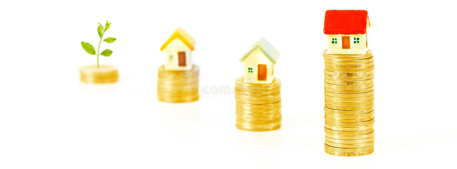 Mini house on coin stack or money. And grow plant stock photography