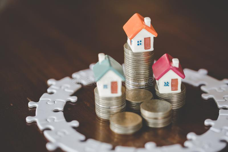 Mini house on stack of coins,Money and house, Mortgage concept, Real estate investment, Save money with stack coin.  stock images