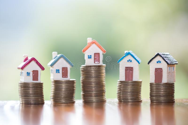 Mini house on stack of coins,Money and house, Real estate investment, Save money with stack coin, Mortgage concept.  royalty free stock image