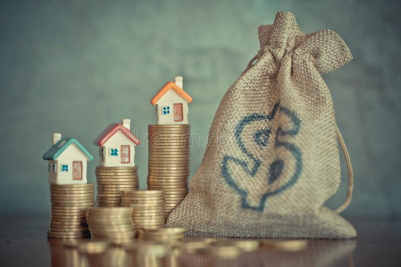 Mini house on stack of coins,Money and house, Real estate investment, Save money with stack coin, Mortgage concept.  royalty free stock photos