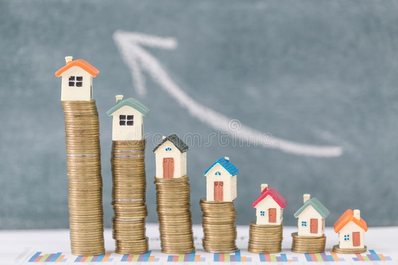 Mini house on stack of coins,Money and house, Real estate investment, Save money with stack coin, Mortgage concept, Real estate. Growth stock image