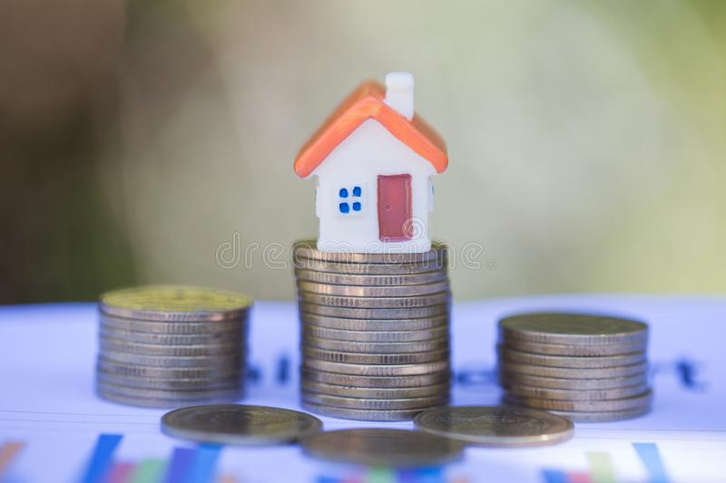 Mini house on stack of coins,Money and house, Real estate investment, Save money with stack coin, Mortgage concept.  stock photos