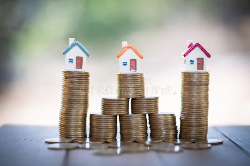 Mini house on stack of coins,Money and house, Real estate investment, Save money with stack coin, Mortgage concept.  royalty free stock photo