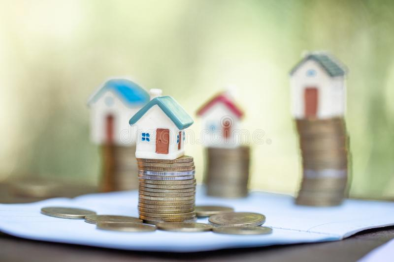 Mini house on stack of coins,Money and house, Real estate investment, Save money with stack coin, Mortgage concept.  stock image