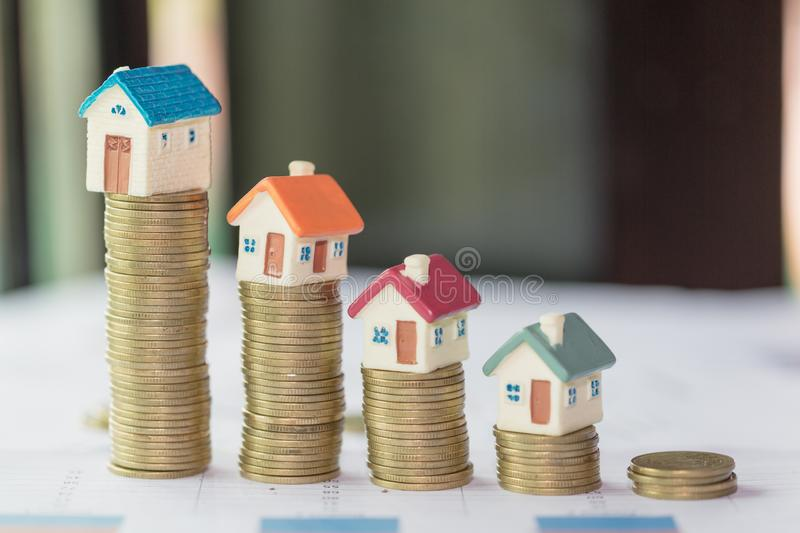 Mini house on stack of coins,Money and house, Real estate investment, Save money with stack coin, Mortgage concept, Real estate. Growth royalty free stock images