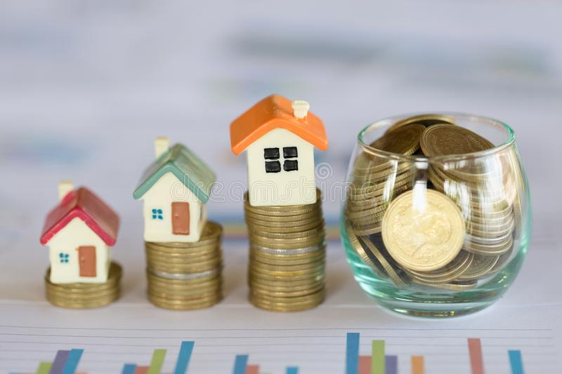Mini house on stack of coins,Money and house, Real estate investment, Save money with stack coin, Mortgage concept, Real estate. Growth stock photos