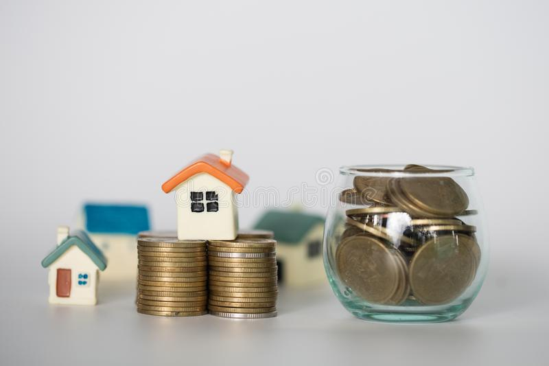 Mini house on stack of coins,Money and house, Real estate investment, Save money with stack coin, Mortgage concept. Isolated royalty free stock image