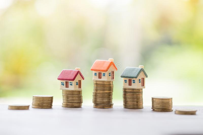 Mini house on stack of coins, Real estate investment, Save money. With stack coin, Business growth investment and financial, Mortgage concept royalty free stock photo