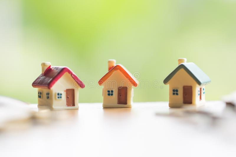 Mini house on the table, Money and house, Mortgage, Savings money for buy house and loan to business investment for real estate. Concept. Invesment and Risk royalty free stock images