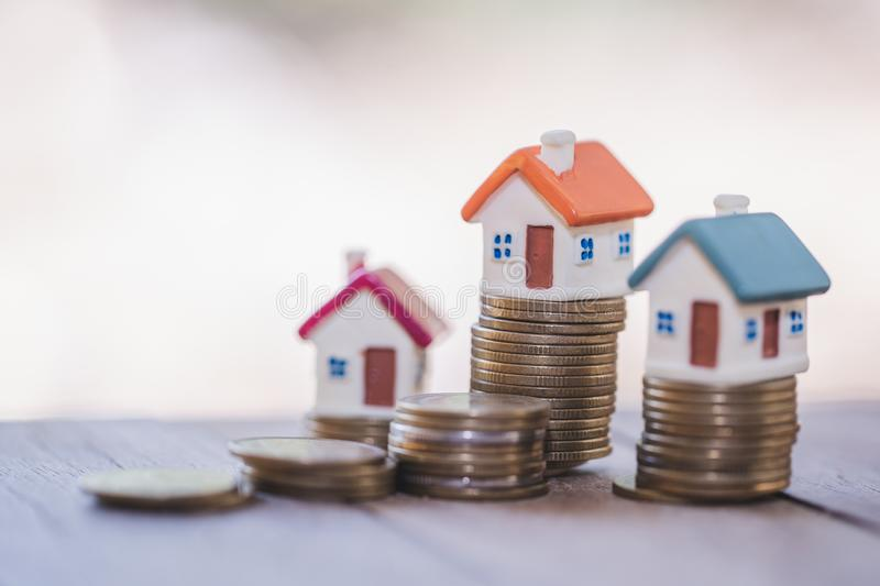 Mini house on the table, Money and house,  Mortgage, Savings money for buy house and loan to business investment for real estate. Concept. Invesment and Risk royalty free stock photography