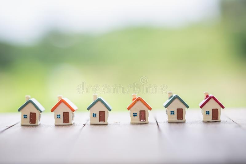 Mini house on the table,   Mortgage, Savings money for buy house and loan to business investment for real estate concept. Invesment and Risk Management stock images
