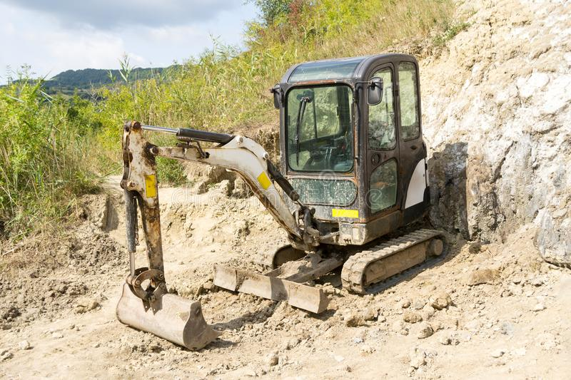 Mini hydraulic excavator stock photo