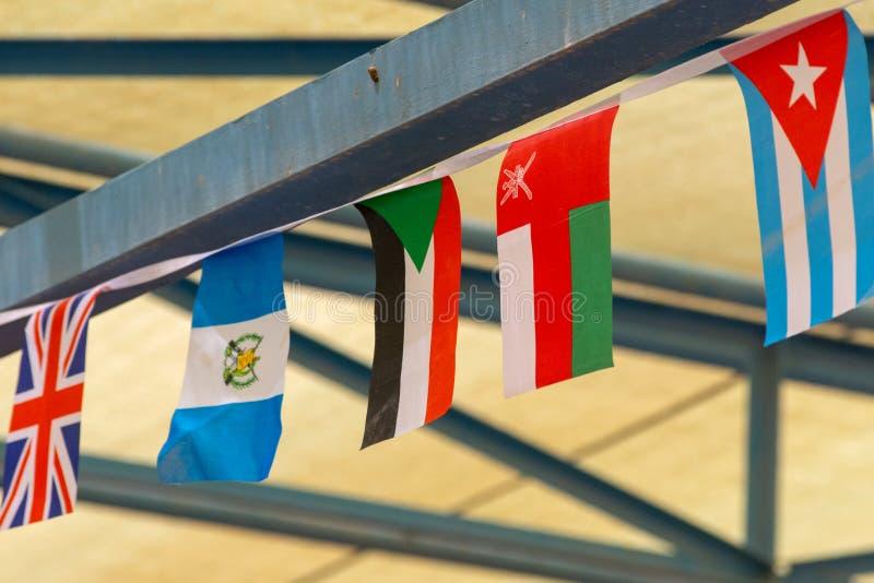 Mini International Flags ad un evento immagini stock libere da diritti