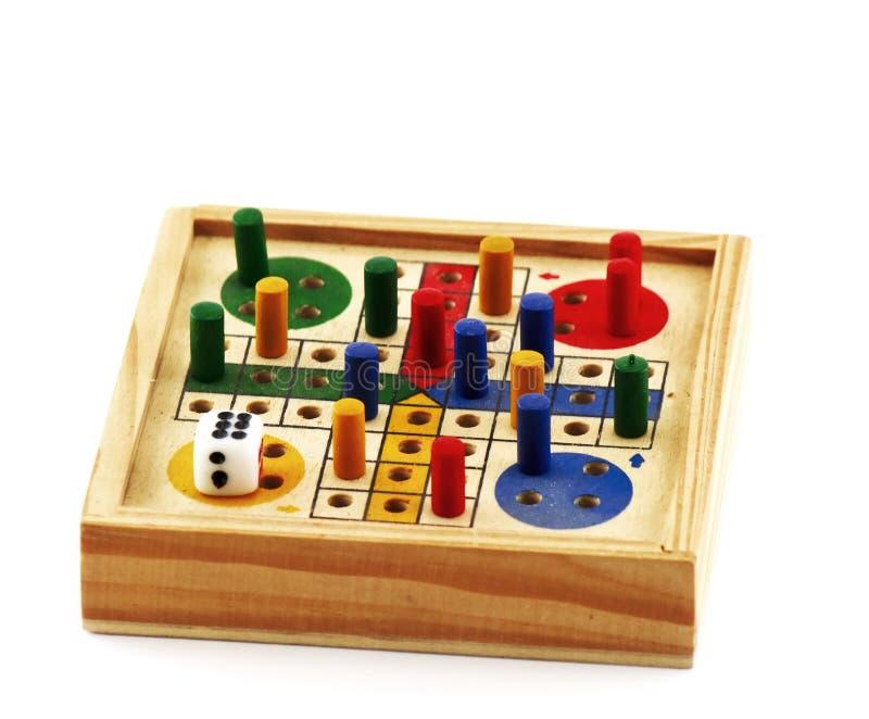 Mini jeu de société à l'arrière-plan blanc images stock