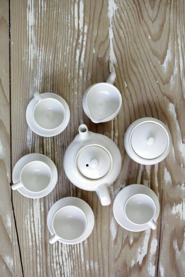 Mini juego de té hecho a mano imagenes de archivo