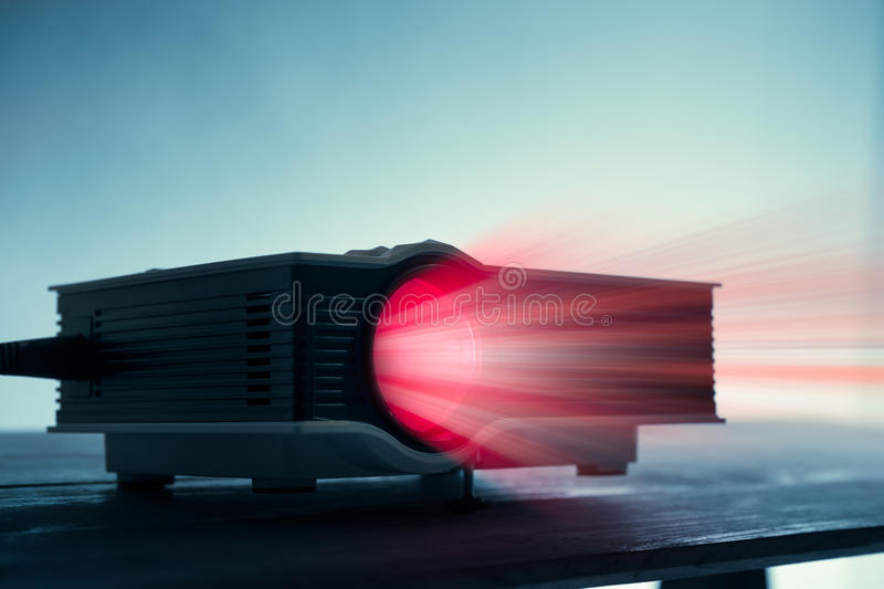 Mini led projector on table in dark blude tone projector home th. Eater background stock photos