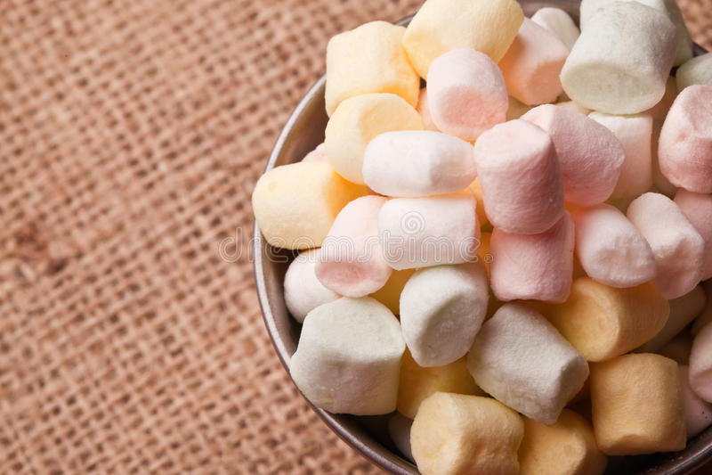 Mini marshmallow. Colorfull mini marshmallow in a tiny bowel royalty free stock photos