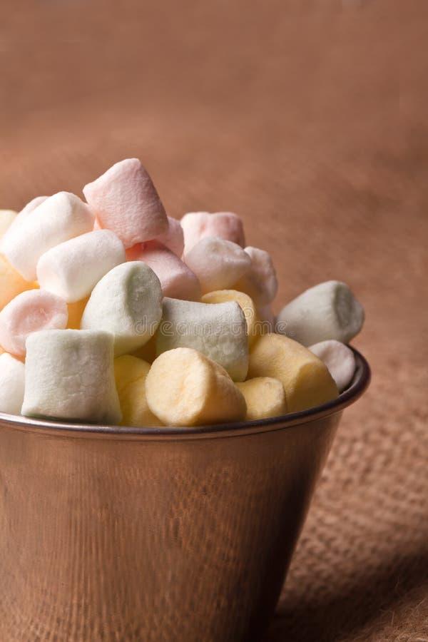 Mini marshmallow. Colorfull mini marshmallow in a tiny bowel royalty free stock image