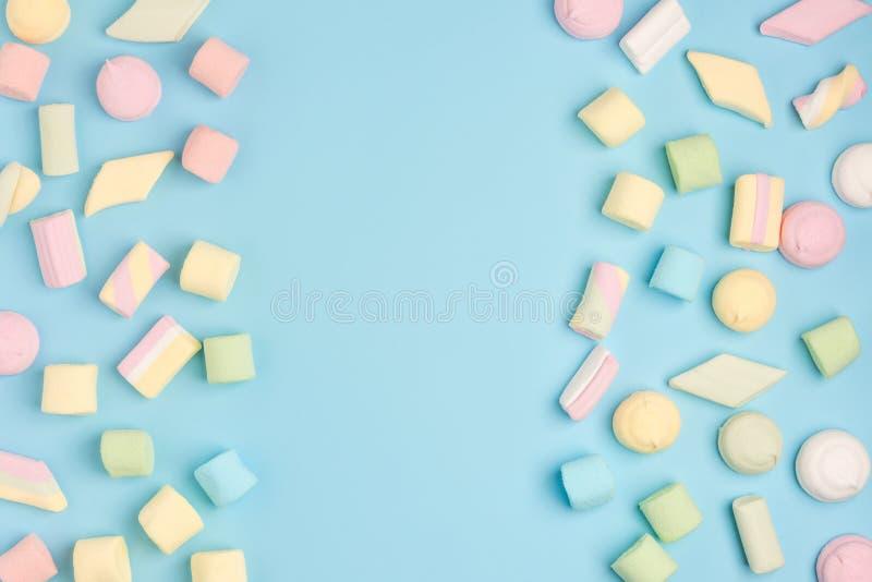 Mini marshmallows on trendy pastel blue background stock photo