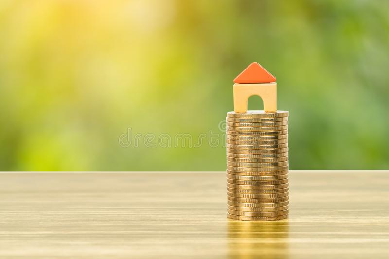 Mini model house on coins stack concept for mortgage, finance, and saving royalty free stock photo