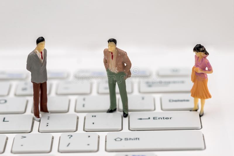 Mini people on a computer stock photo