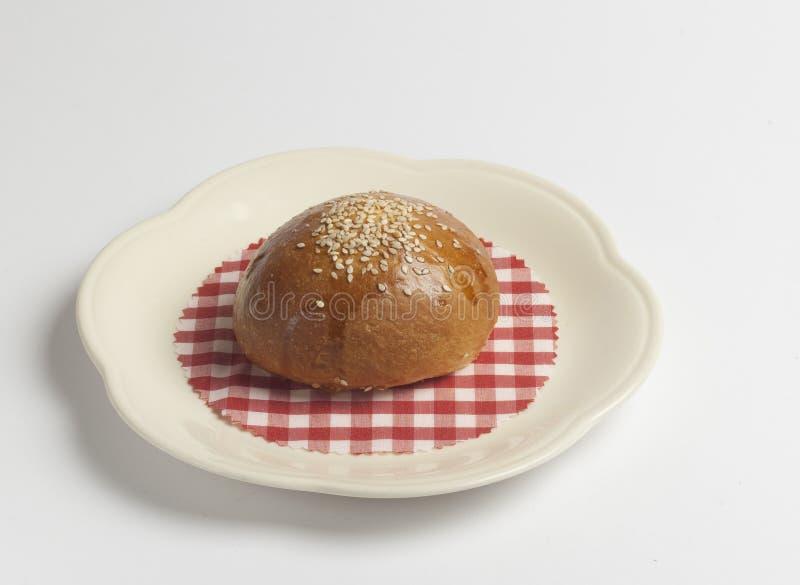Mini petit pain de pâtisserie, sésame de petit morceau de petit pain image libre de droits