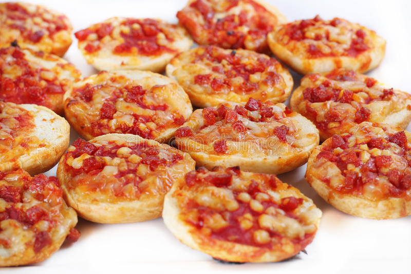 Mini pizza bagels on white