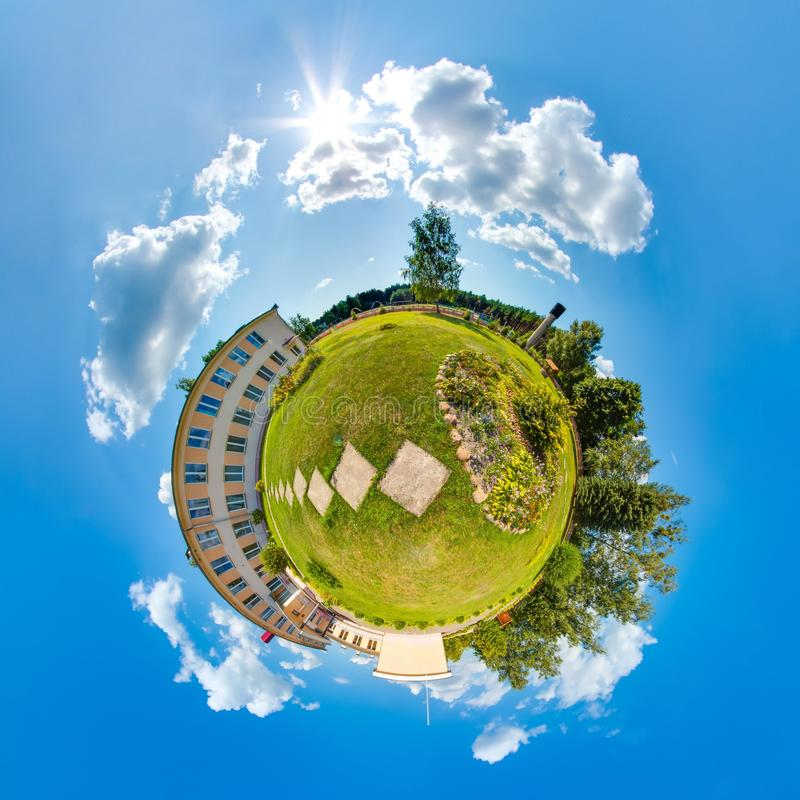 Mini planet Earth. Little planet earth with 360 viewing angle. Globe panorama of world. Summer little planet with trees, green royalty free stock photo