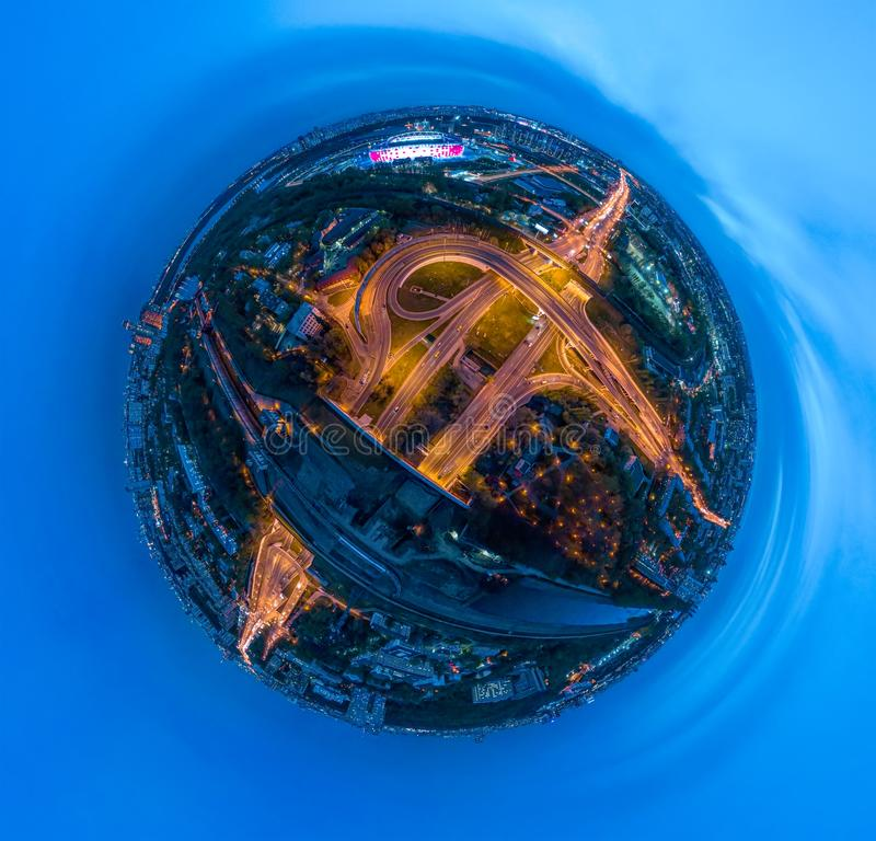 Mini planet Night Aerial view panorama of a freeway intersection traffic trails in night Moscow royalty free stock images